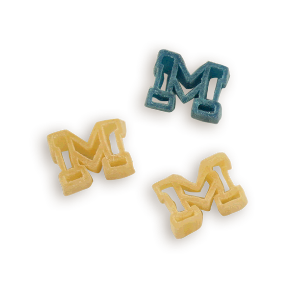 Michigan Block M Pasta Shapes. Logo shaped pasta in your team colors with a delicious vinaigrette mix included!  Perfect for tailgate parties, game day celebrations or a gift for a crazy fan!  Serves 6-8.